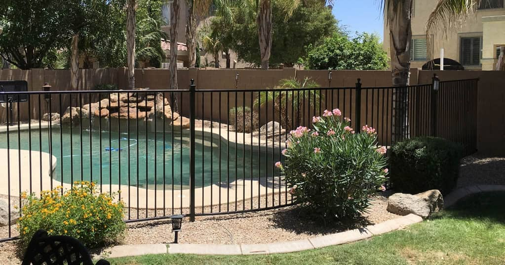 iron pool fence around swimming pool